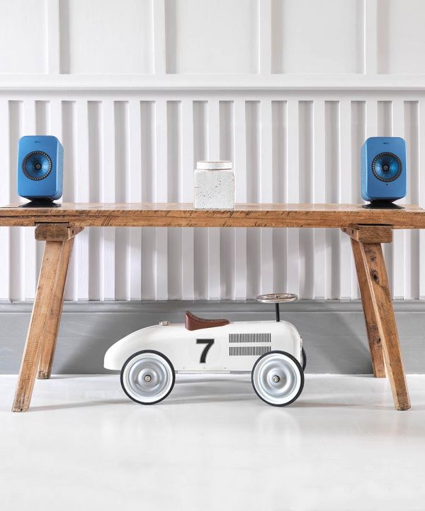 KEF Speaker Desk Stand for LSX Wireless Speakers in black with blue speakers. Table top speaker stand.